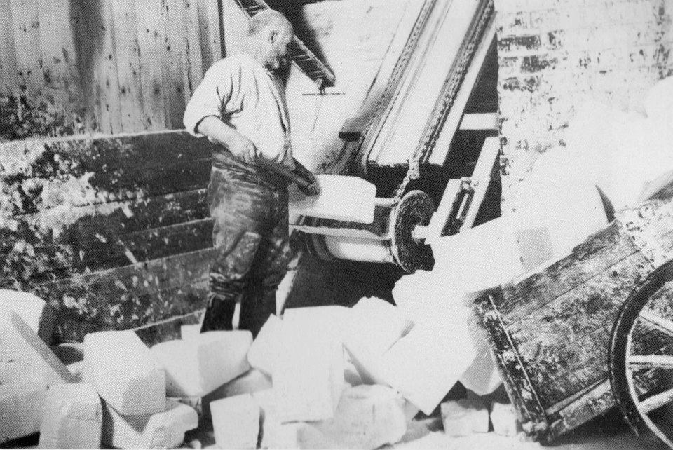 A worker loading the Salt blocks on to a conveyor belt-dated around 1906