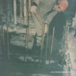 Night-shift slipforming, shoveling in the concrete