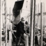Placing concrete on the slipform deck for the first mini-tower