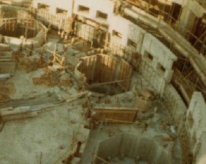 View on 1st Pressure Vessel after concreting the first level, showing the voids for the boilers and the second ring of precast units being lifted into place